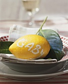 Lemon with the word 'Gaby' on plate