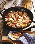 Fried potatoes with sausage, tomatoes and cheese