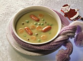 Pea soup with cocktail sausages for children