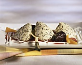 Poppy seed mousse with fruit sauce