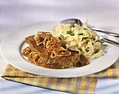 Steak and onions with ribbon pasta
