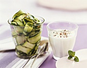 Courgette salad in glass and yoghurt dressing