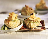 Strudel purses filled with risotto and shrimps