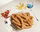 Too much meat: a heap of Frankfurters on plate