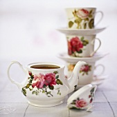 Rose-patterned teapot and teacups
