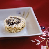 Small sesame cakes in square bowl