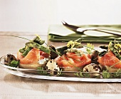 Artichoke bottoms with smoked salmon and green asparagus