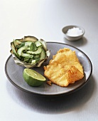 Haddock fried in batter with cucumber salad