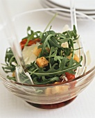 Pepper salad with rocket, croutons and Parmesan