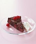 Piece of chocolate raspberry cake with cream (gluten-free)