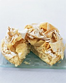 Apple pie with filo pastry crust, partly sliced