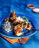 Barbecued chicken kebabs on rice