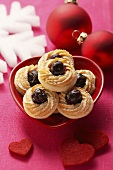 Christmassy piped biscuits with cherries
