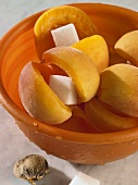 Apricots, filled with sugar cubes, in dish