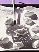 'Spanish wind' (hemispherical meringues) on baking tray