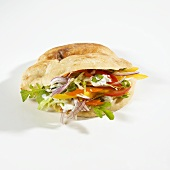 Döner kebab with vegetables and sour cream