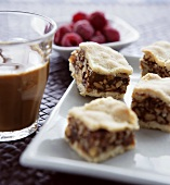 Chocolate nut cake, coffee and raspberries