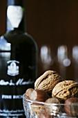 Walnuts, hazelnuts and bottle of Madeira