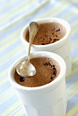 Chocolate creams in two white beakers