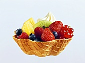 Fruit salad with cream in wafer bowl