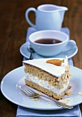 Piece of carrot cake with almonds, cup of coffee