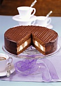 Chocolate cream gateau, a piece cut