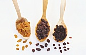 Sultanas, raisins, currants on wooden spoons