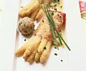 Asparagus gratin with ham and bread dumpling