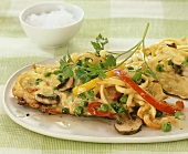 Spaetzle noodle omelette with vegetables and mushrooms
