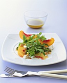 Savoury peach salad with goat's cheese, rocket and hazelnuts