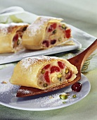 Marzipan strudel with Amarena cherries and pistachios