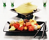 Exotic fruit salad with star anise and cinnamon stick