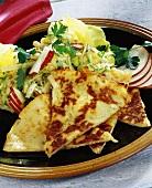 Potato pancakes with salad
