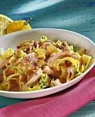 Ribbon pasta with salmon fillet and parsley