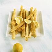Fried scorzonera with lemon wedges