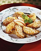 Caramelised apple wedges with sesame cooked in a wok