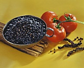 Black beans, tomatoes and bunches of pepper