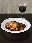 Risotto with chicken, peppers and chorizo, glass of red wine