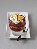 Plum trifle with whipped cream