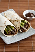 Peking duck with plum sauce and spring onions