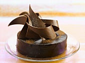Chocolate truffle cake with artistic chocolate decoration