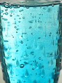 Blue water in glass