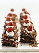 Several pieces of Black Forest cake