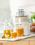 Peach juice with electric juicer