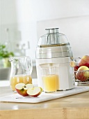Freshly pressed apple juice with electric juicer