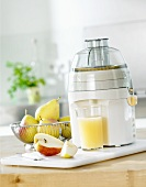 Freshly pressed pear juice with electric juicer