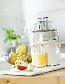 Freshly pressed pear juice with electric juicer