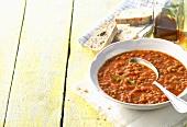 Lentil soup, white bread and olive oil
