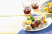 Chicken and vegetable kebabs and red wine (Greece)