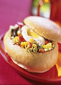 Bread roll filled with salad, pepper and egg